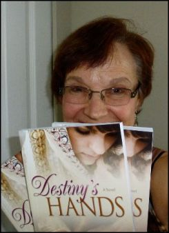 Violet Nesdoly with her new novel, Destiny's Hands