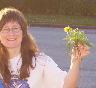 Janet Sketchley holding uprooted dandelion