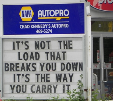 Sign: It's not the load that breaks you down. It's the way you carry it.